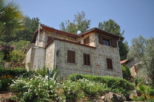 Причудливая каменная вилла в Узюмлю Фетхие