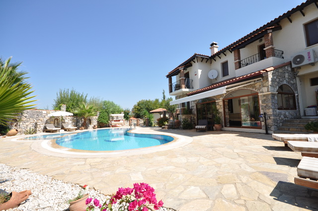 An Amazing Villa with Large Garden in Ovacik For Sale