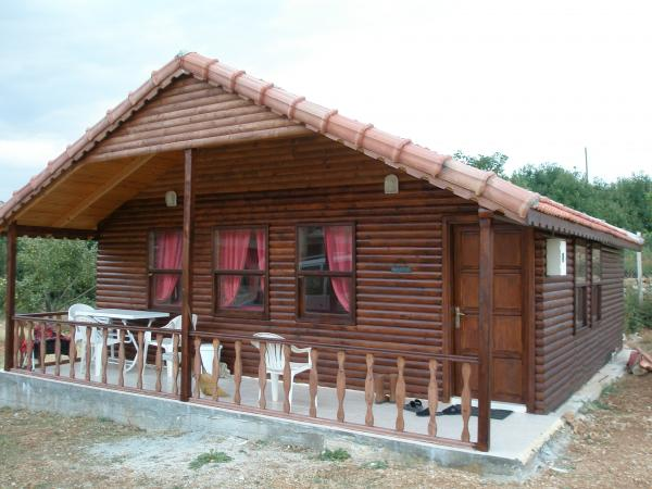 Wooden Chalet on Private Land in Gombe For Sale