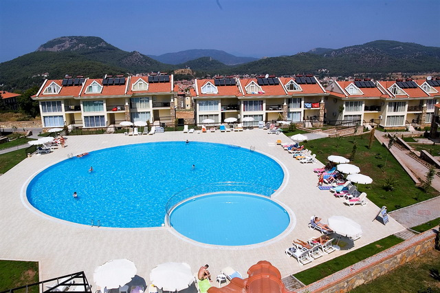Three Bedroom Duplex Apartment For Sale in Ovacik / Fethiye