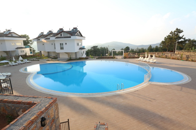 Two Bedroom Ovacik Apartment in a Luxurious Complex For Sale