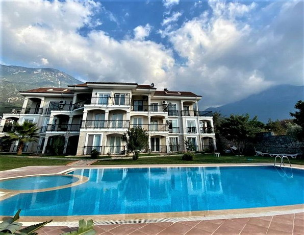 2 Bedroom  Reverse Duplex Apartment on Private  Complex For Sale