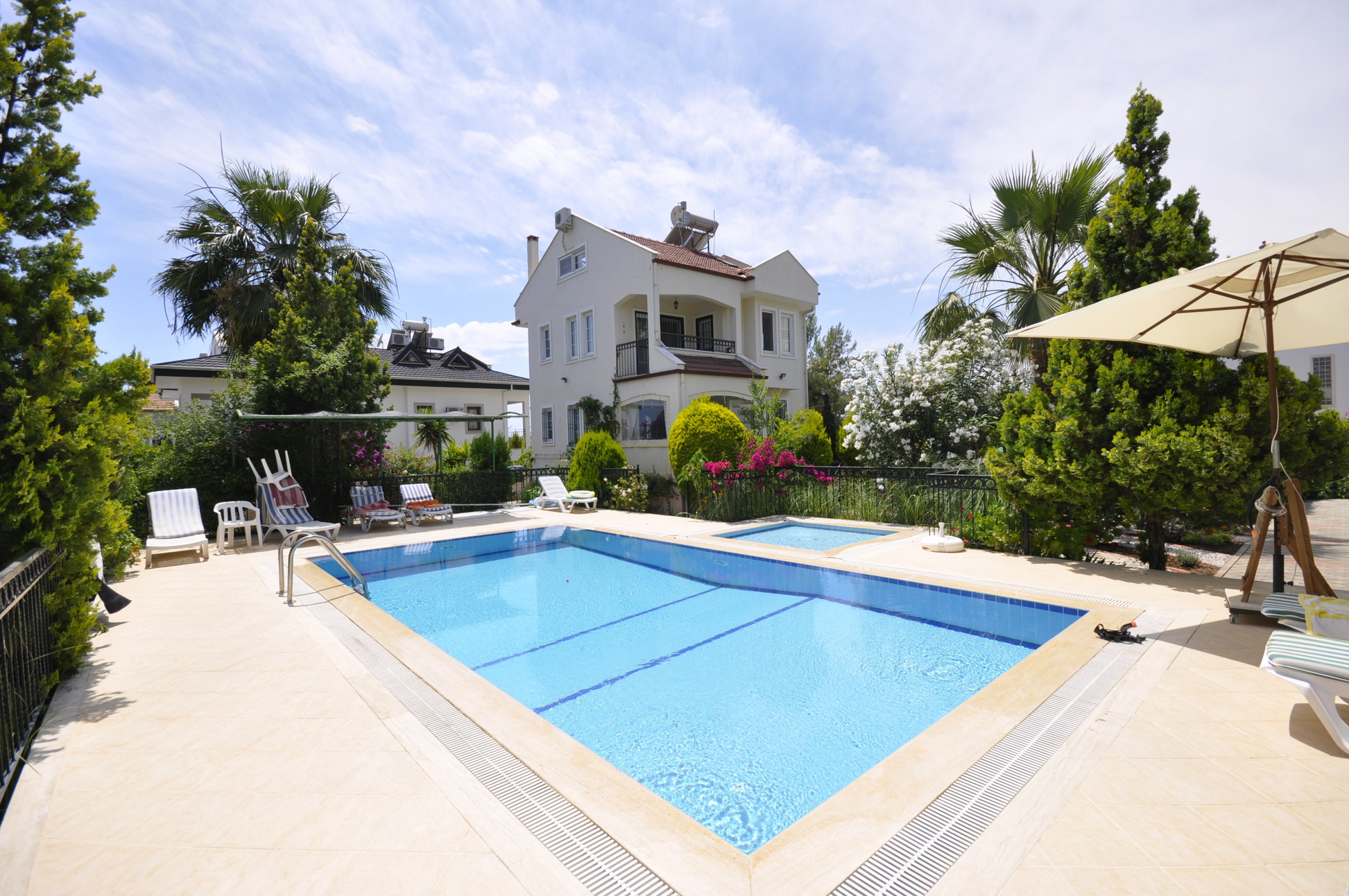 Beautifully Kept Quadruplex Villa with Private Gardens & Shared Pool